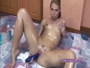 Blonde Lina covered in oil and fucking her toy