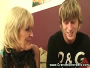 Granny giving head to younger guy