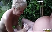 Granny Swinger Giving A Hand Job Outdoors